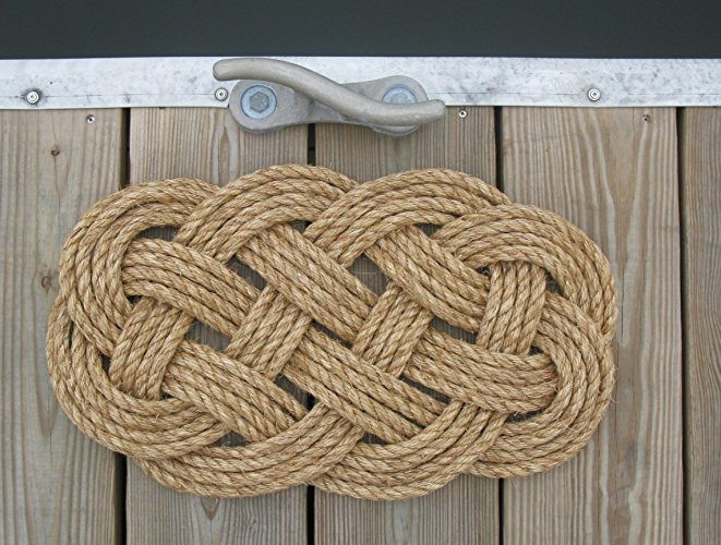"""Ocean Plait Manila Outdoor Mat Rug   This classic rope mat is made with 50 feet of 1/2"""" grade 1 manilla rope. A Petite 12 x 21 inches, it will last for years outdoors. Perfect for back doors or smaller spaces, use it to wipe off your boots before coming inside. This mat has also been used as a table center piece. Beautiful for a rustic look.  $50.00"""