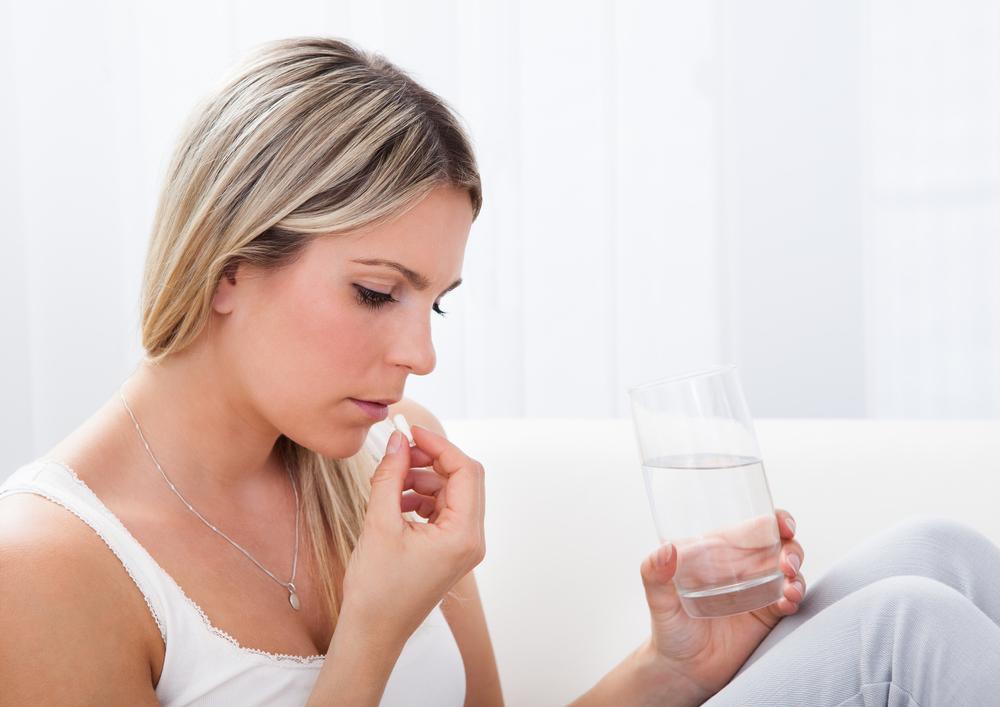 woman-taking-vitamin-pills.jpg
