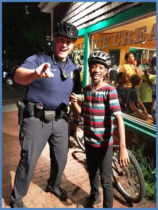 A Provincetown Police officer with a visitor on Commercial Street.