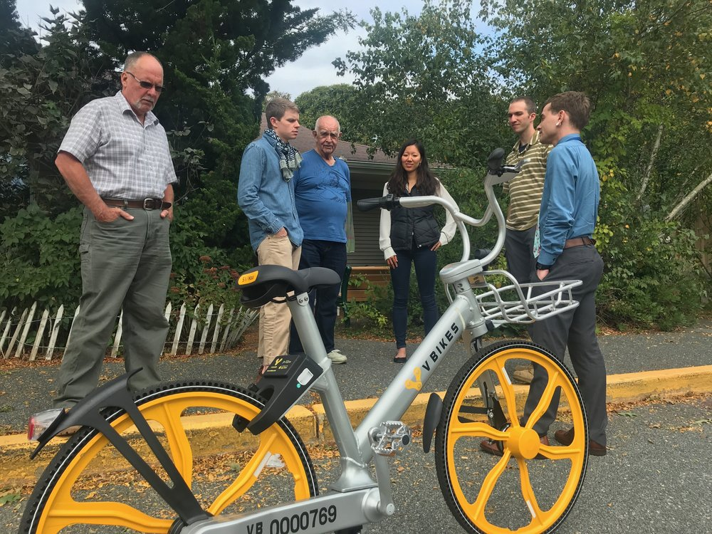 Committee members and town staff chat with representatives from vBikes about their dockless bike share.