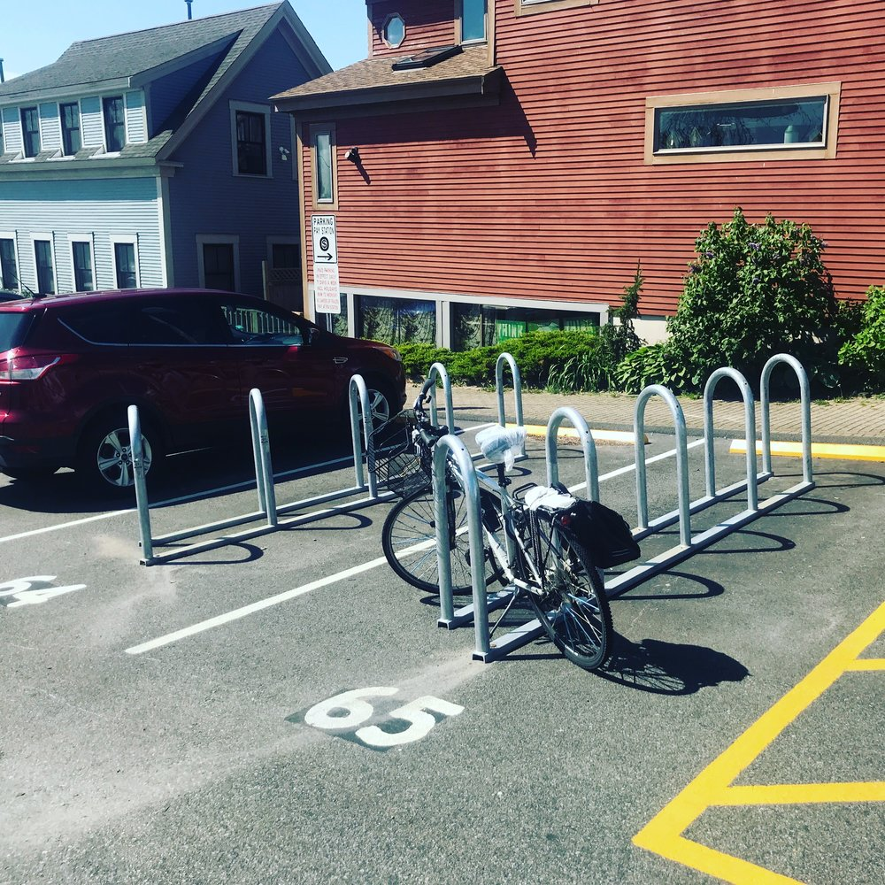 Bike corrals in parking spaces at the Johnson Street Parking Lot in Provincetown (2018). Each corral can hold 10 bicycles.