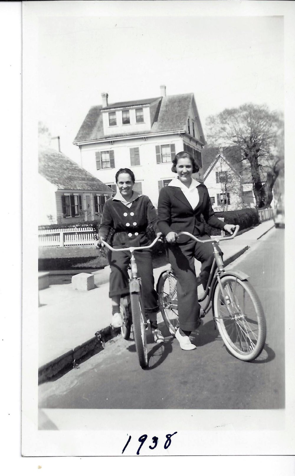 """My mother, Marguerite and my aunt Marion Henrique Thomas on their bicycles in the vicinity of Lovetts Court and Commercial Street, Provincetown 1938"" - Salvador Vasques"