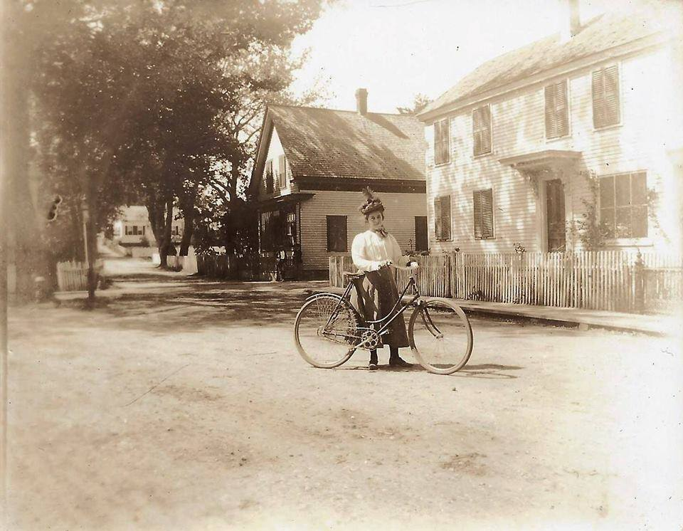 Woman with bicycle on Commercial St at Franklin St circa 1900 - My Grandfather's Provincetown - Lisa King