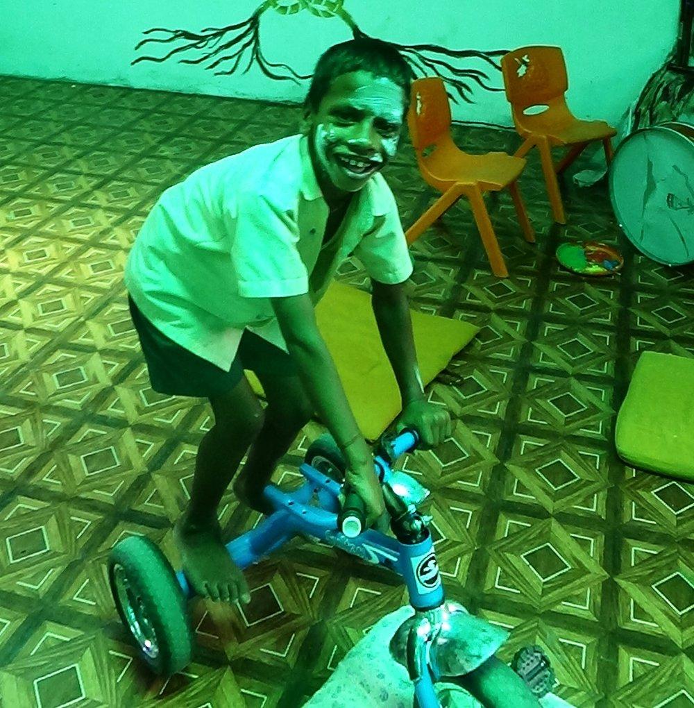 mithun happy on tricycle.jpg