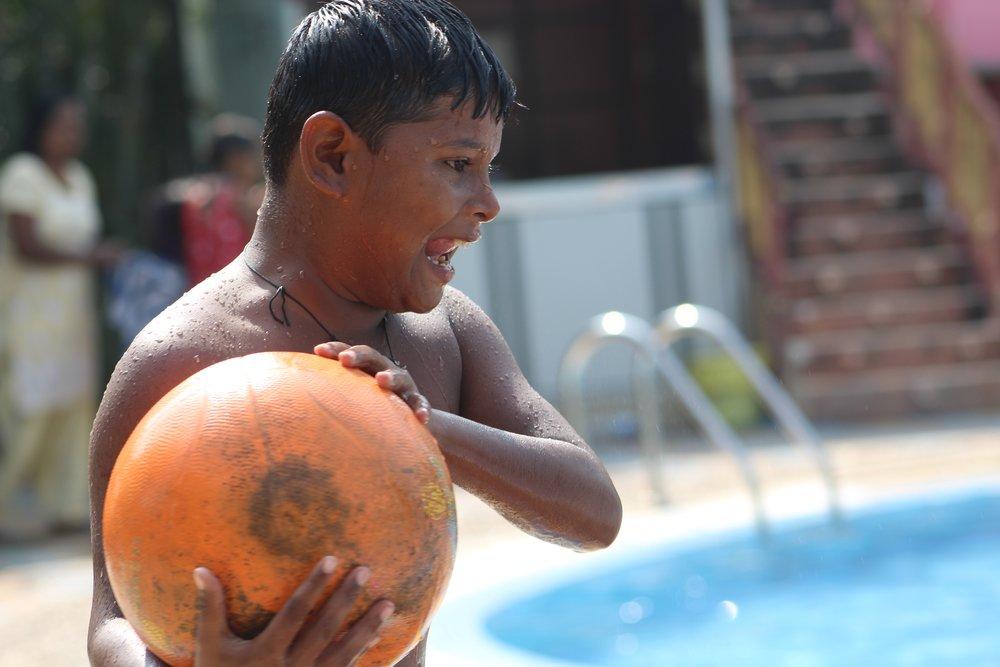 prince with ball at pool.jpg