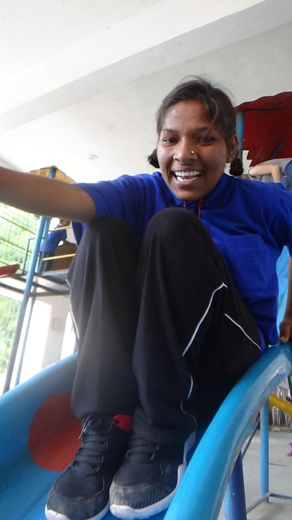 puja loves the slide.jpg