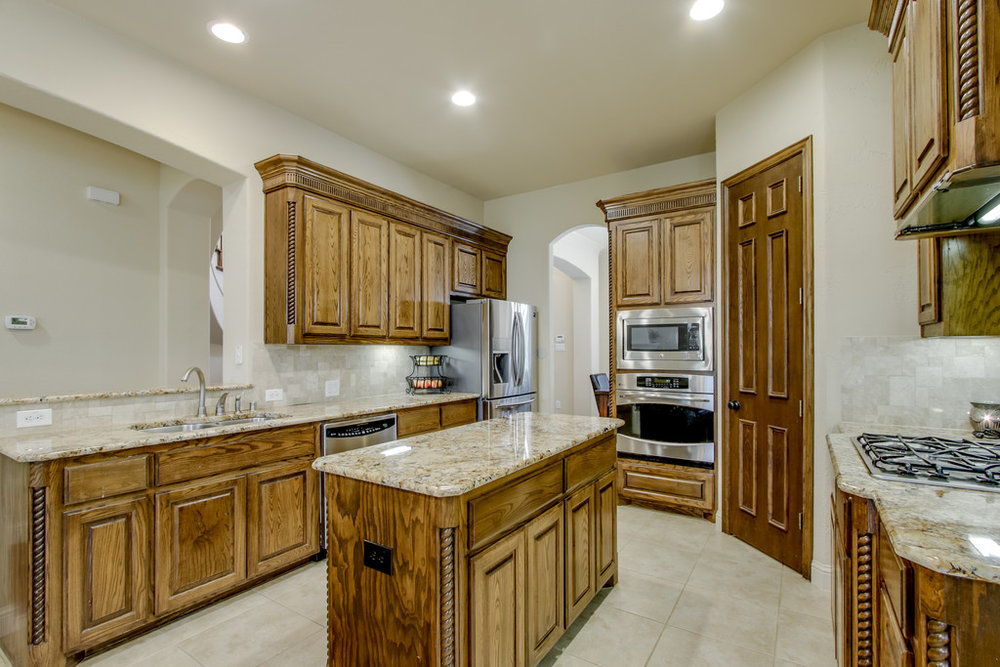"Kitchen w Granite Counters, 42"" Cabinets, Walk in Pantry, SS Appliances, Gas Cooktop & Vent Hood Exhaust."