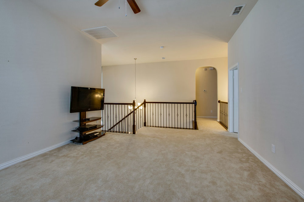 Spacious Game Room w Ceiling Fan.