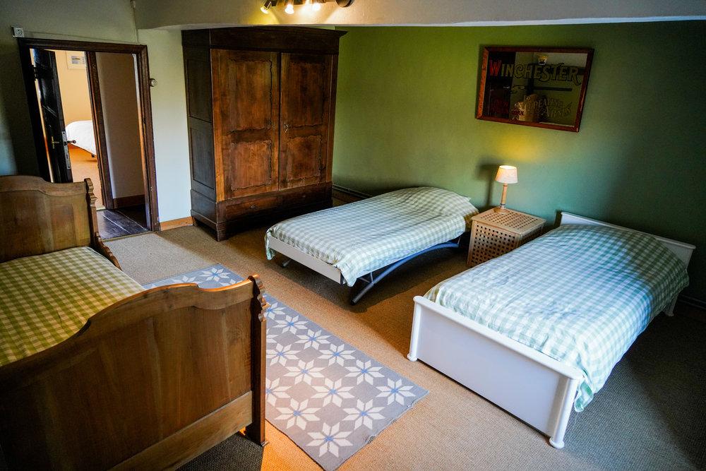 Slaapkamer 3 - Met 3 éénpersoonsbedden.