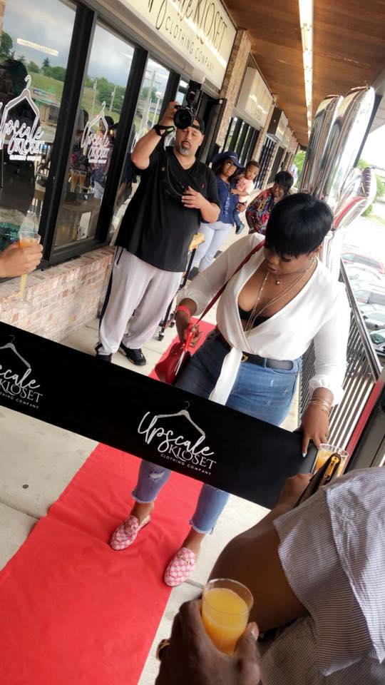 Owner DeJa Lashae pictured cutting the ribbon at the Upscale Kloset Grand Opening