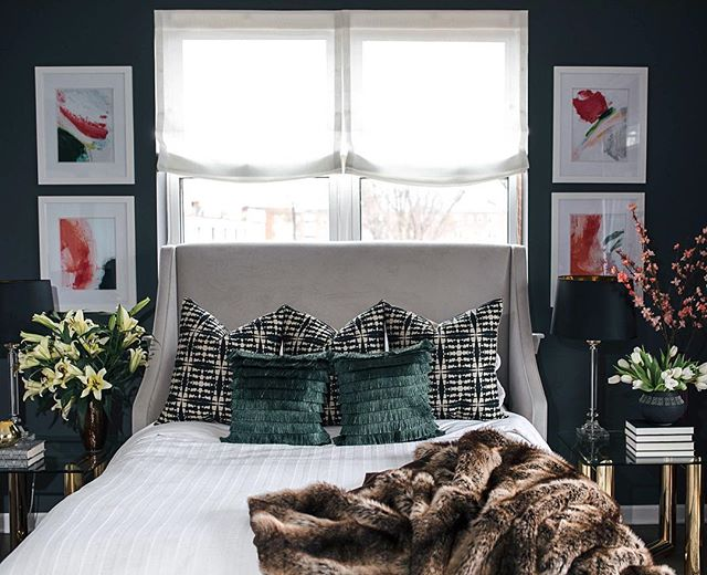 Dark and moody bedrooms are my thing. Especially when they're as cozy as this bedroom from our Kenwood Project with some super cozy elements. Head over to the website to see photos of the spaces I designed in this modern condo. #interiordesign #artwork #furthrows #surya #luxury #whitebedding #freshflowers #customromanshades #boldprints #richcolors #karlspringer #moderncondo #chicagointeriordesigner