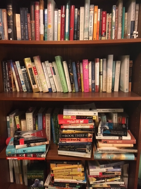 Here is a picture of one of my actual bookcases at home...most of these books will eventually end up in the used section at Cream & Amber!