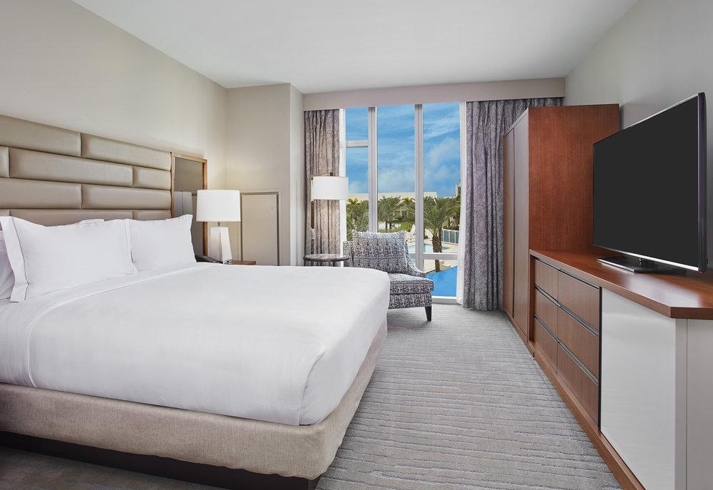 King_Premium_Suite_Pool_View_Bedroom smaller.jpg
