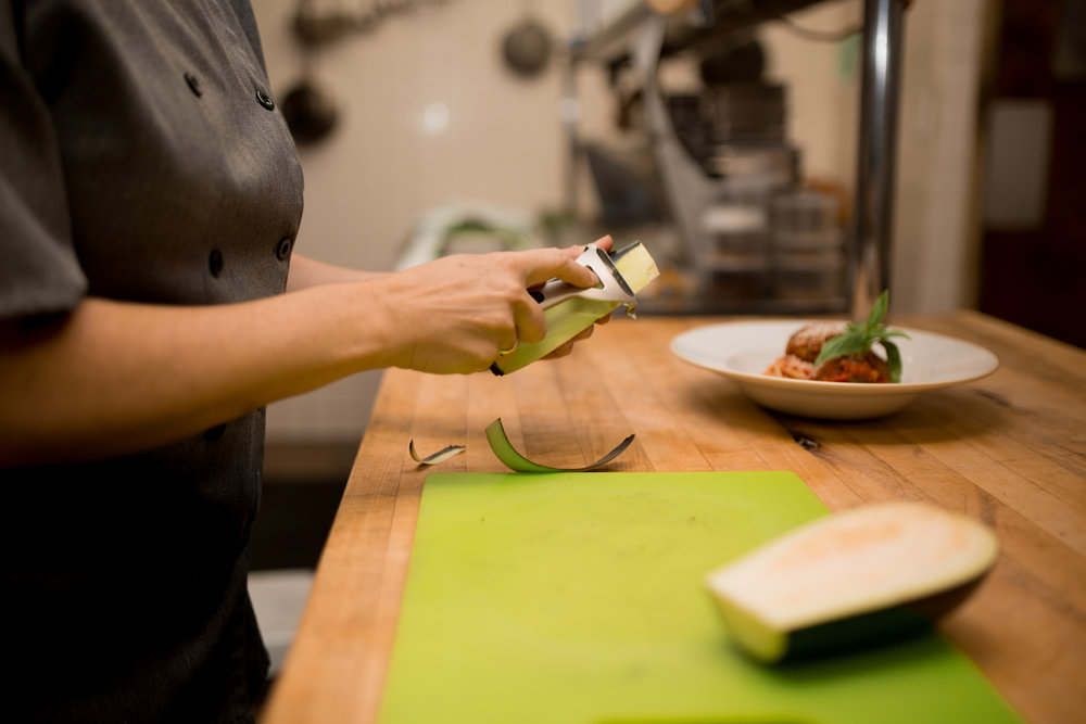 Chef Noelle easily peels the eggplant with a vegetable peeler to remove the tough skin.