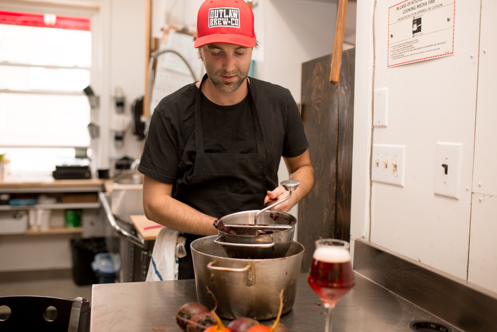 Andrew Woodley of  Outlaw Brew Co.  makes the red beet reduction for 'Hi-Berry Beet' Beer