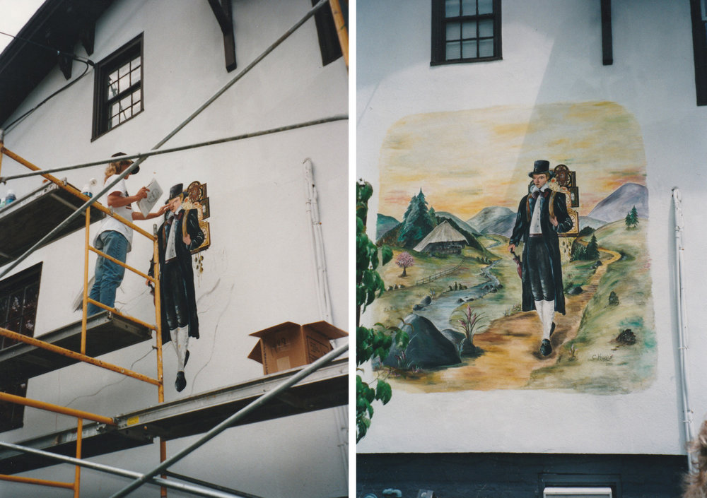 June 2000 - Our friend Conny Haas from the Black Forest paints the clock peddler mural on the side of our building.