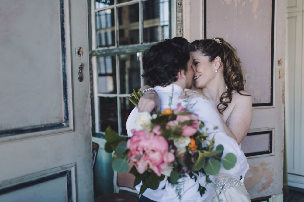Ryan and Alex Industrial Metropolitan Building Long Island City Bride and Groom Couple Sustainable Eco-friendly wedding celebration floral hair and makeup