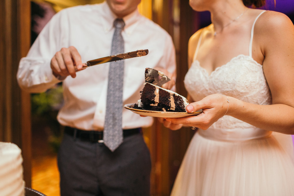Vegan cake cutting at their rustic summer barn wedding at waterloo village