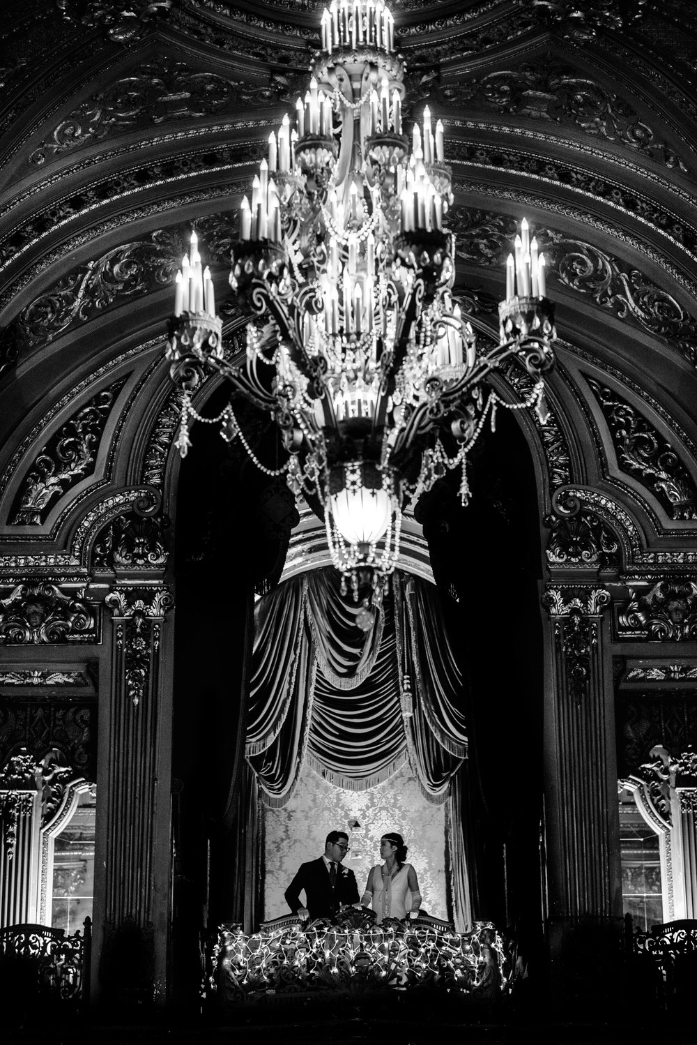 Beautifully black and white picture of 20's Inspired bride and groom at historic Loew's Theater in Jersey City