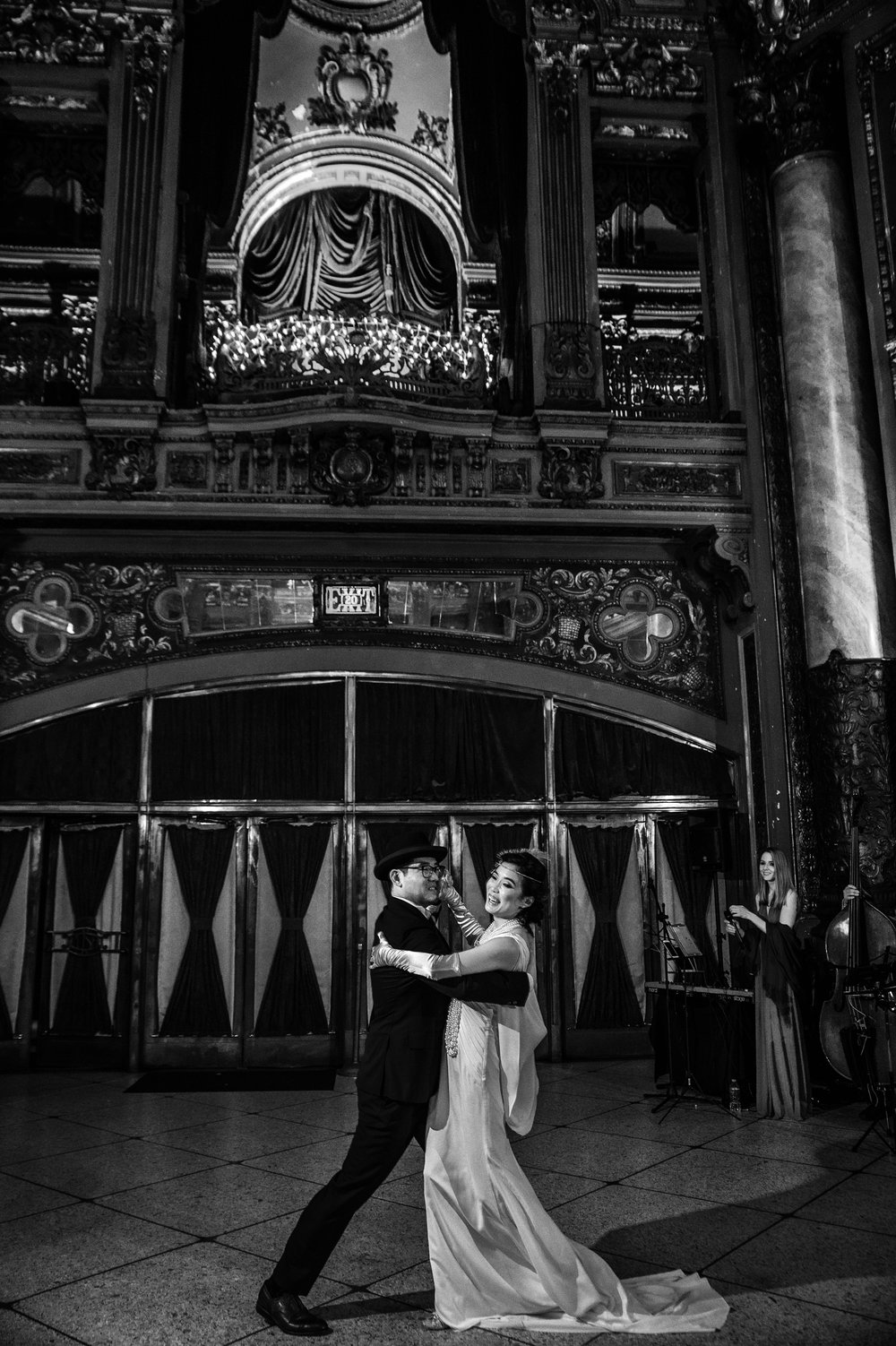 Beautifully black and white picture of 20's Inspired bride and groom dancing at reception at historic Loew's Theater in Jersey City