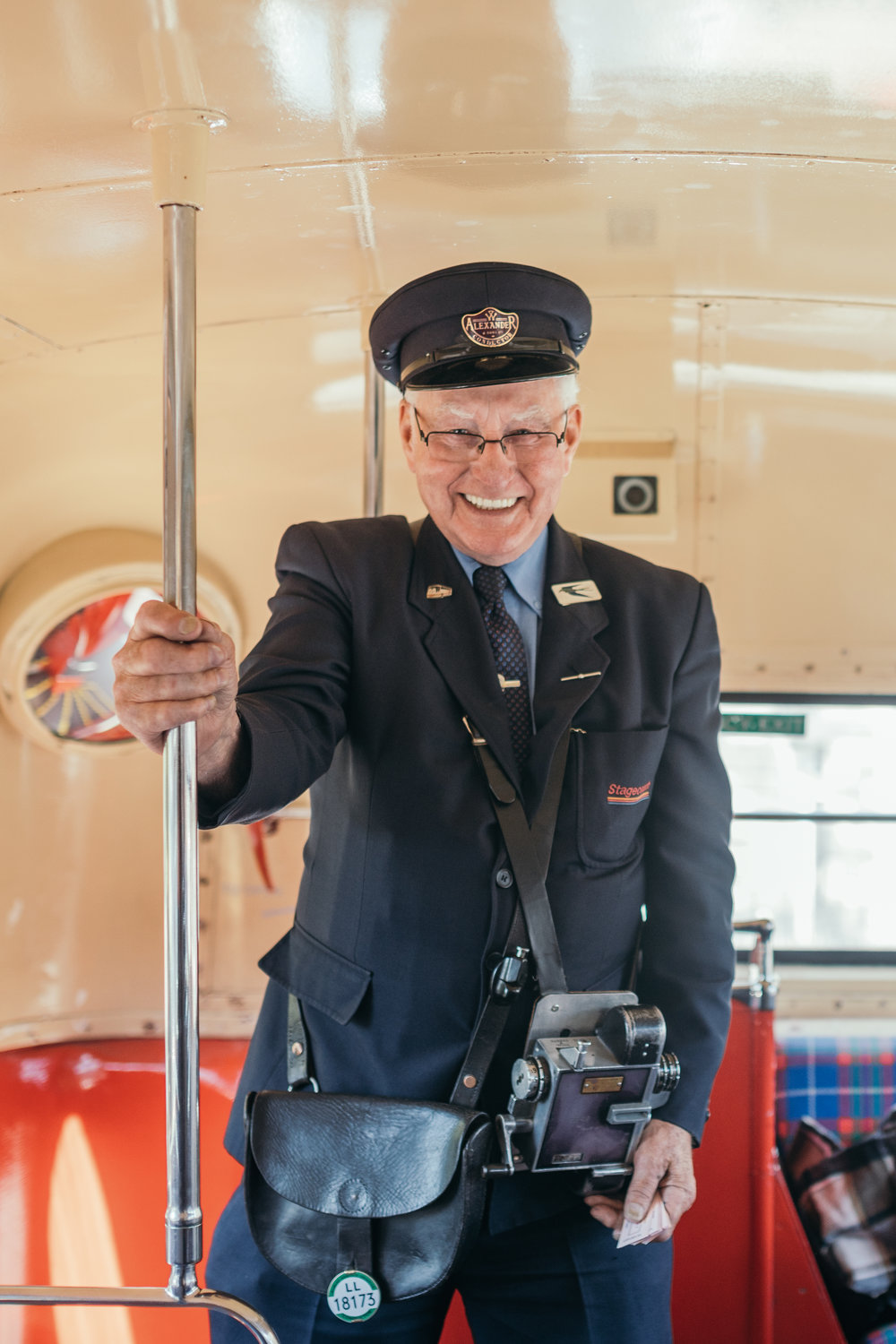 Conductor on a vintage double decker bus in Edinburgh, Scotland at Carlowie Castle Wedding