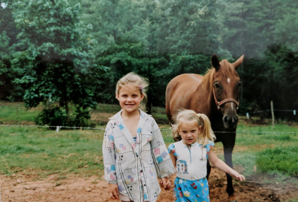 Sisters+Holding+Hands,+Horse+in+Background.jpg