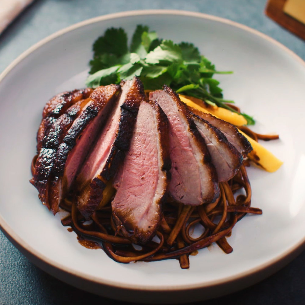 INGREDIENTS : - 4 x Silver Hill aromatic duck fillets 2Tbsp x hoi sin sauce 270g x soba noodles 80ml x soy sauce 1tbsp x sesame oil 1tbsp x brown sugar Juice of 1 lime 1 mango, sliced 2 sprigs x coriander