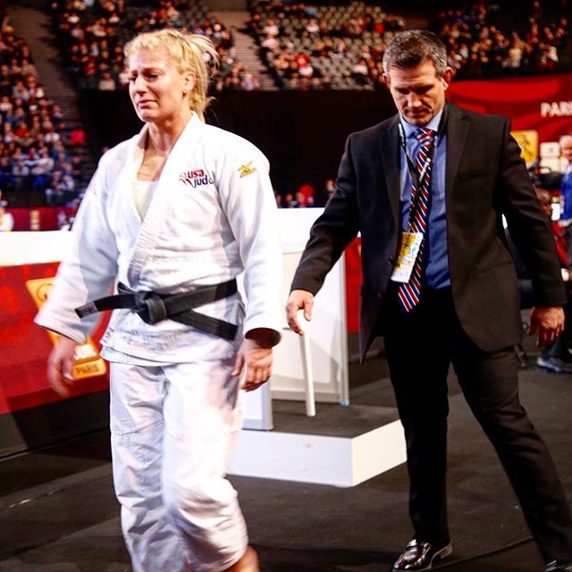 This is a pic from the 2016 Paris grand slam. Jimmy told me this tourney was my test run for Rio; That I should treat it like the Olympics and find a way to win no matter what.  All day I was on fire. Winning all of my matches in dominant fashion. Mentally I was ready To finally win that elusive Paris gold.  In the final I faced my long time rival, Mayra of Brazil. I felt good, I felt relaxed, I felt like I was going to win. But I didn't. I got bombed about 1:30 into the match.  I still think about that day and I still watch that match more often than I probably should. Although it pains me that I never won Paris, it brightens me to remember how much that loss fueled me for the last leg of my career. I woke up the next morning before the sun was up and went for a run. I didn't skip a day or a session or a minute of training from that cold February morning until Rio.  Nothing burns hotter than the heat of failure. I was a woman obsessed.  It would be the last match I ever lost.  So just remember- Sometimes the sting is just a wake up call.  The memories aren't always pretty, but they can always be motivating.  #MondayMotivation