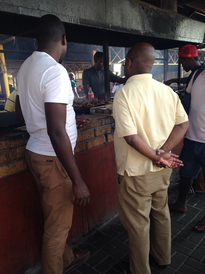 My husband and father tasting out meet at a Namibian open market.