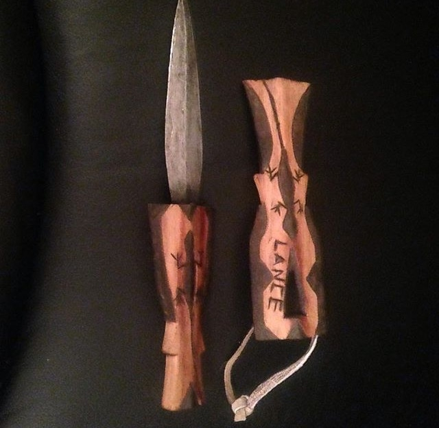 A traditional double-edged knife my husband had made and engraved for our son before his birth.