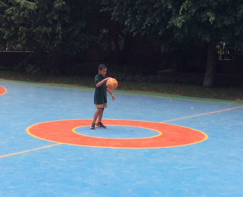 Kristen's son shooting some hoops.