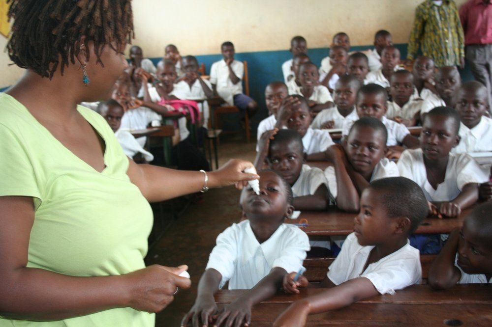 Michelle conducting homeopathic malaria prevention at a primary school in Bukavu, DRC.