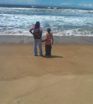 Teri and Son at Beach in Liberia.jpg