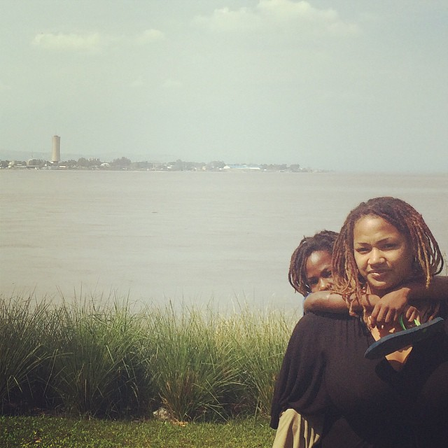 Adiya and her daughter with the Congo River behind.