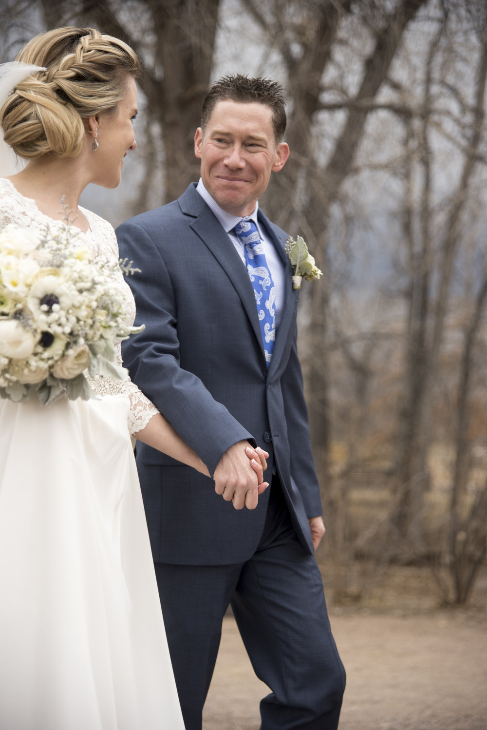 Groom smiling looking at bride | Mary and Brad's Outdoor Wedding at Hudson Gardens | Colorado Springs, Colorado Photographer | Farm Wedding Photographer | Apollo Fields Wedding Photojournalism