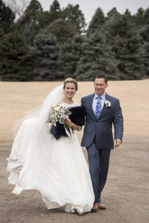Bride and Groom walking arm in arm | Mary and Brad's Outdoor Wedding at Hudson Gardens | Colorado Springs, Colorado Photographer | Farm Wedding Photographer | Apollo Fields Wedding Photojournalism