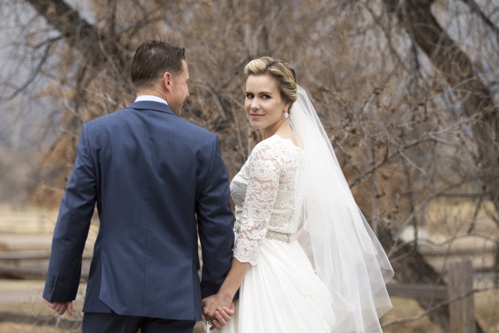 Bride and groom hand in hand | Mary and Brad's Outdoor wedding photography at Hudson Gardens | Colorado Springs, Colorado | Farm Wedding Photographer | Apollo Fields Wedding Photojournalism
