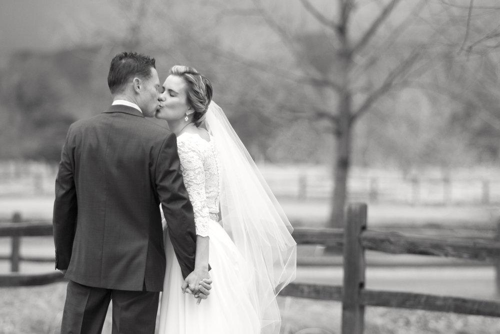 Bride and groom black and white kissing | Mary and Brad's outdoor wedding photography at Hudson Gardens | Colorado Springs, Colorado | Farm Wedding Photographer | Apollo Fields Wedding Photojournalism