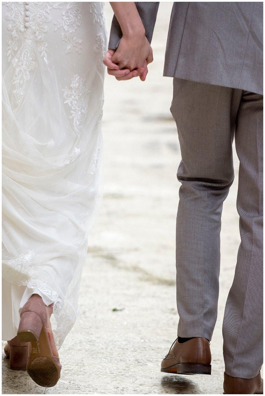 Bride and Groom Holding Hands | Bethany and Jono's Intimate DIY Wedding | Colorado Springs Wedding Photographer | Farm Wedding Photographer | Apollo Fields Wedding Photojournalism