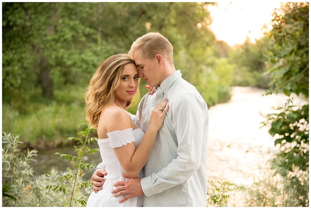 Young Couple Hugging in the Sunset | Clear Creek, Arvada, Colorado | Farm Wedding Photographer | Apollo Fields Wedding Photojournalism