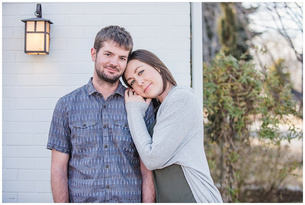 Woman resting head on man's shoulder | Kerry and Patrick's intimate in home engagement session | Sloans Lake, Colorado Photography | Farm Wedding Photographer | Apollo Fields Wedding Photojournalism