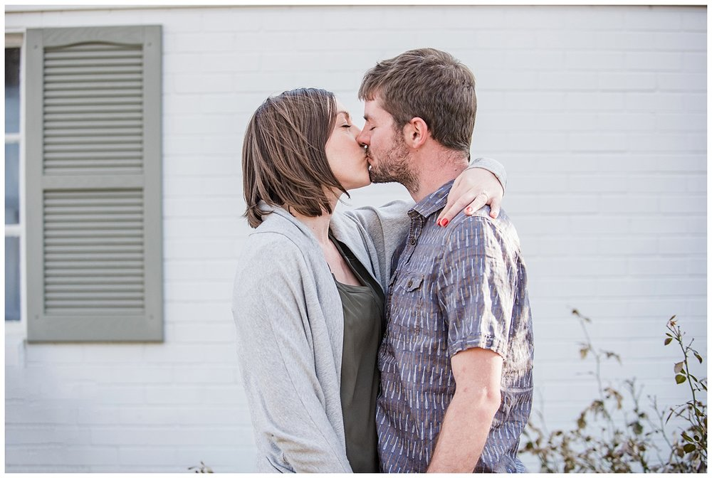 Young Couple Kissing | Kerry and Patrick's intimate in home engagement session | Sloans Lake, Colorado | Farm Wedding Photographer | Apollo Fields Wedding Photojournalism