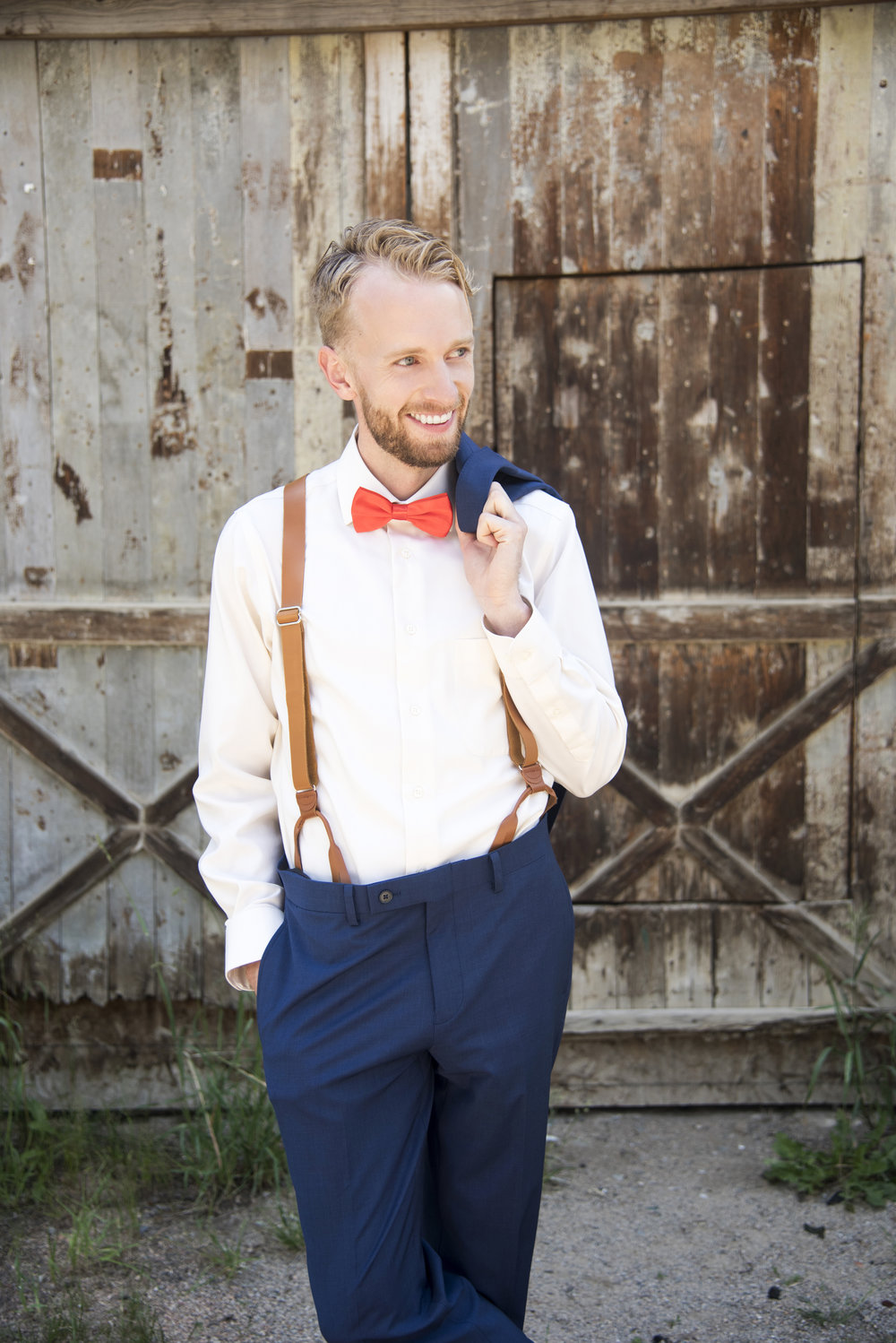 Groom in front of Rustic Mill | Emily and Ole's DIY Outdoor Wedding in Georgetown Colorado | Guanella Pass Campground Wedding | Apollo Fields Wedding Photojournalism