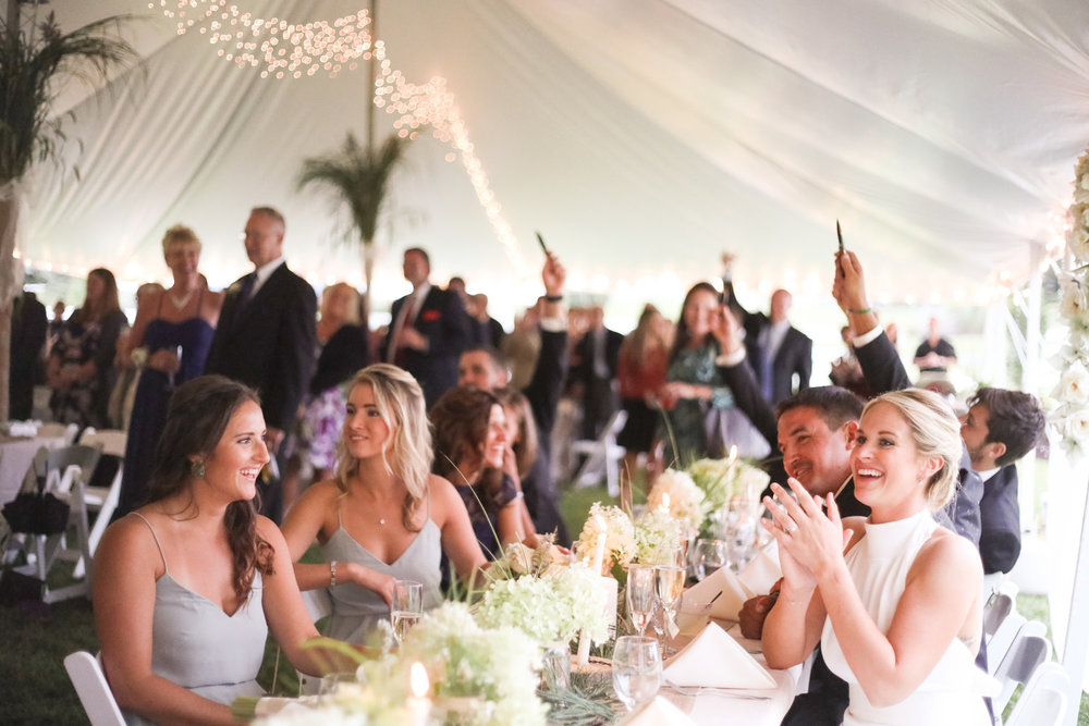 Bride and Bridesmaids Clapping Tableside | Tori and Colin's Outdoor Equestrian Wedding in Upstate New York | Farm Wedding Photographer | Apollo Fields Wedding Photojournalism