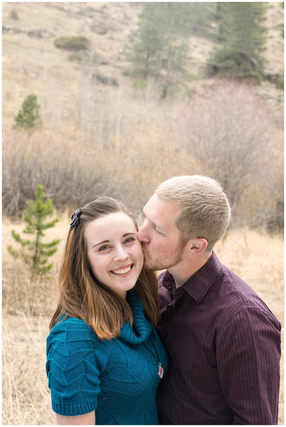 Man Kissing Woman | Mountain Engagement Photography | Golden Colorado Wedding Photographer | Farm Wedding Photographer | Apollo Fields Wedding Photojournalism