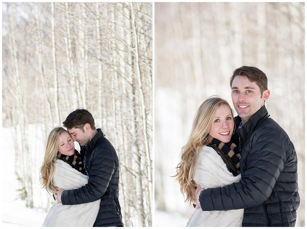 Couple Embracing in the Snow | Lake Dillon Colorado Engagement Photographer | Farm Wedding Photographer | Apollo Fields Wedding Photojournalism