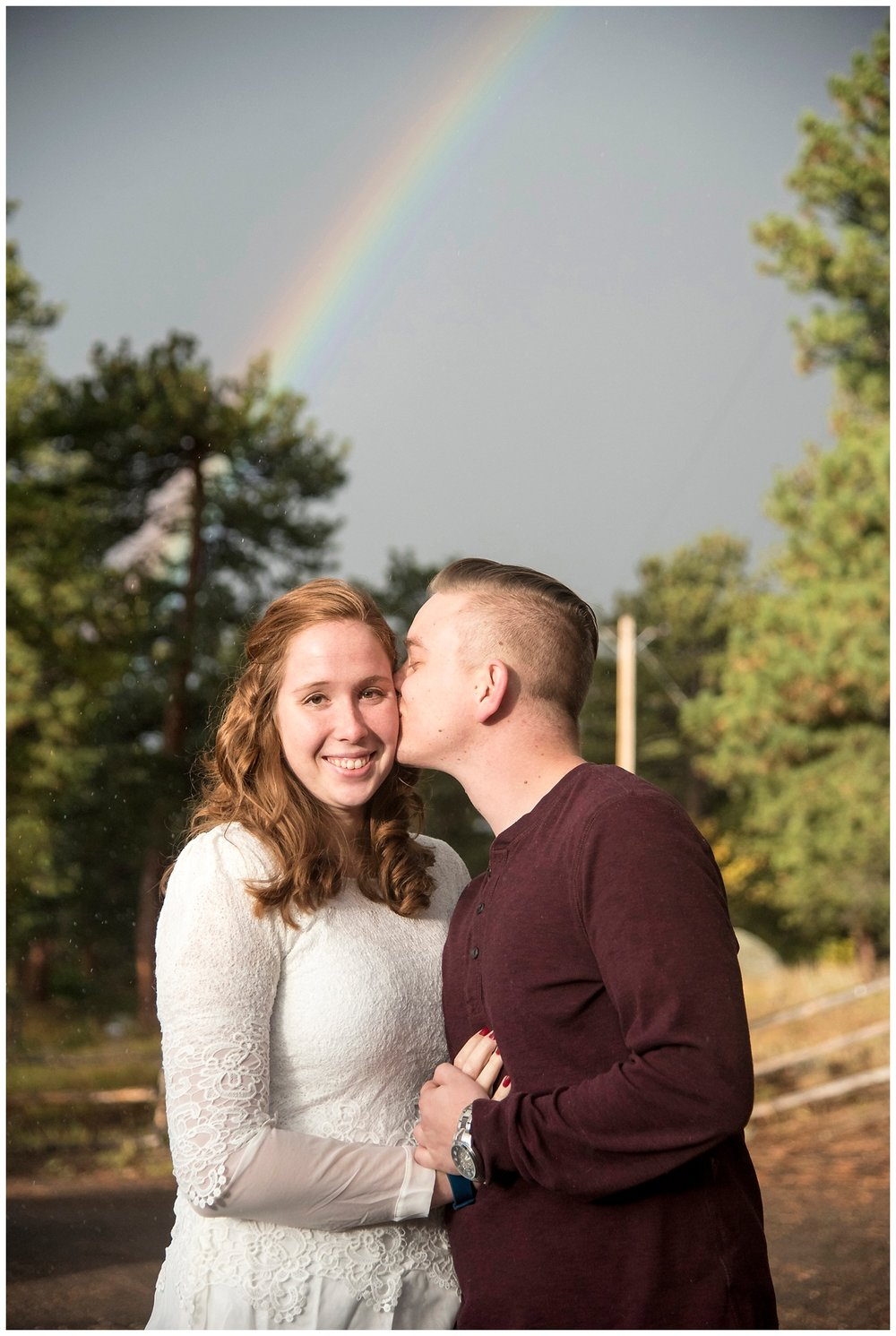 Man Kissing Woman with Rainbow | Don & Aliyah's Mountain Engagement Photography | Farm Wedding Photographer | Apollo Fields Wedding Wedding Photojournalism