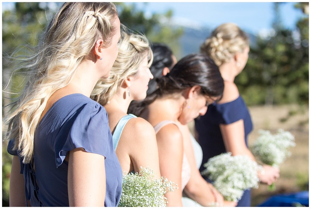 Over the Shoulder of Bridesmaids at Altar | Carolyn and Shawn's Wild Horse Inn Wedding at Devil's Thumb Ranch | Fraser Colorado Photography | Farm Wedding Photographer | Apollo Fields Photojournalism