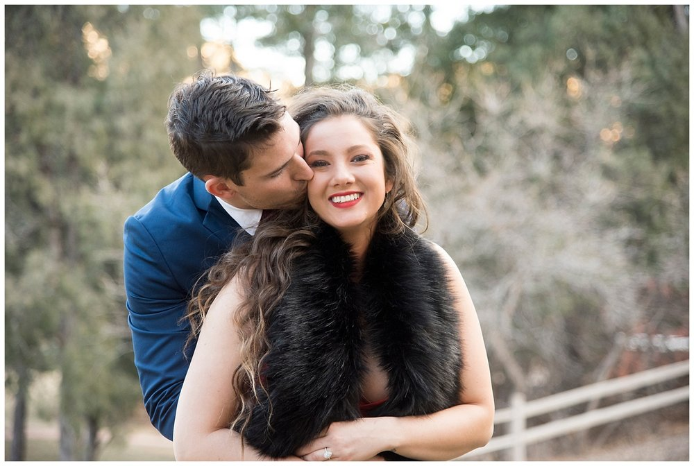 Man Hugging Woman From Behind | Nicholas and Eden's Surprise Proposal at Glen Eyrie Castle | Colorado Springs Photographer | Farm Wedding Photographer | Apollo Fields Wedding Photojournalism