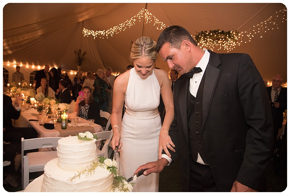 Cutting the cake at the wedding, Upstate NY Wedding Venues Farm Weddings